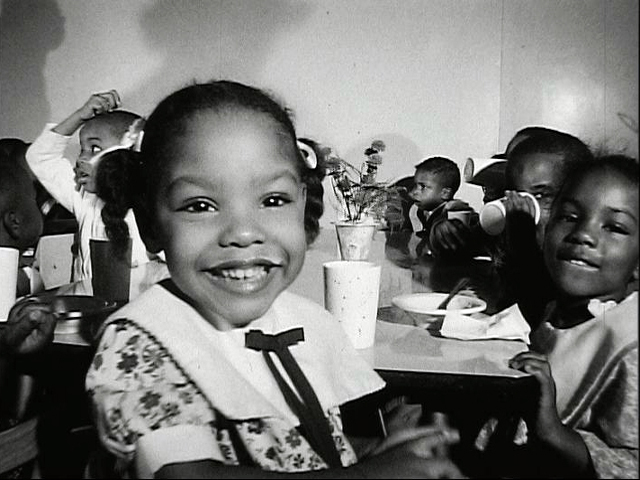 Happy African-American girl smiling at the camera.